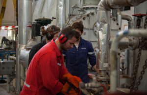 Student in working group, in engine room